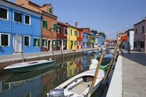 The typical colorful houses reflected in the canal, Burano, Venice, Veneto, Italy — Stock Photo