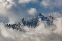Cadini of Msurina emerging from the clouds, Dolomites, Veneto, Italy — Stock Photo