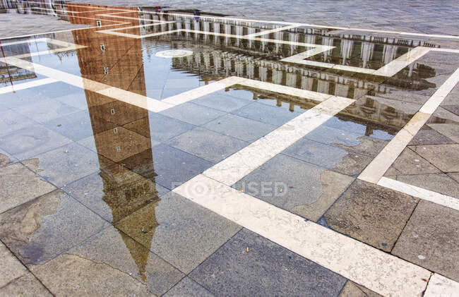 Reflection of the San Marco bell tower on high water in San Marco square, Venice, Veneto, Italy, Europe — Stock Photo