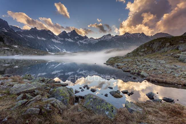 A sunset at Black lake into the Adamello-Brenta natural park, Nero lake, Adamello Brenta natural park, Trentino-Alto Adige, Italy — Stock Photo
