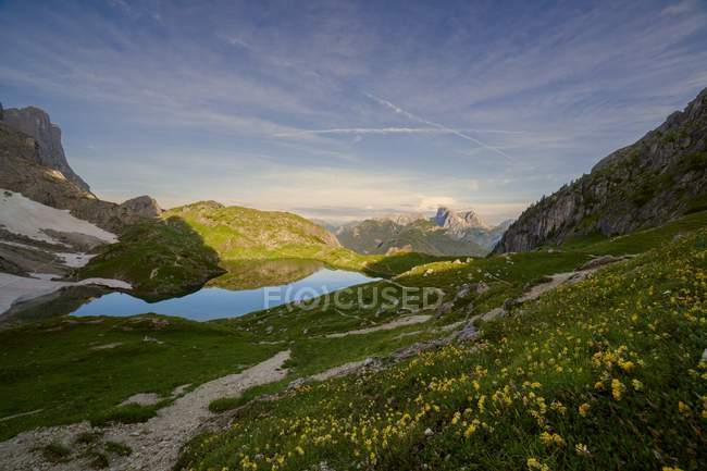 The basin with mountain lake Coldai towards the Marmolada, Civetta group, Dolomites, Veneto, Italy — Stock Photo