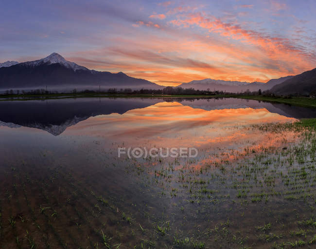 Panoramic view of Pian di Spagna flooded with Mount Legnone reflected in the water at sunset Valtellina Lombardy, Italy, Europe — Stock Photo