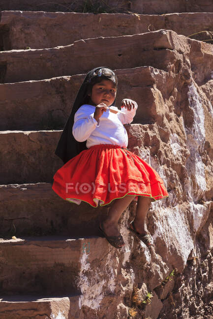 Child dressed for a ceremony on Isla Taquile on the Peruvian side of Lake Titicaca, Puno province, Peru — Stock Photo