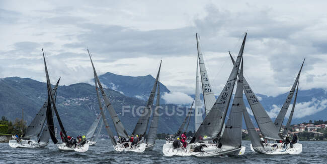 Sailboats racing on Lake Como, Mandello del Lario, Lombardy, Italy, Europe — Stock Photo