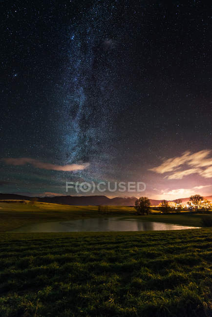 Starry night over lake of prairies, Non Valley, Trentino-Alto Adige, Italy — Stock Photo