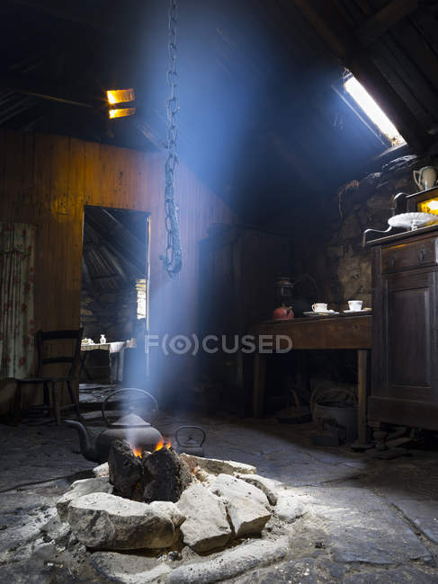 Arnol Blackhouse No 42 on the Isle of Lewis in the Outer Hebrides. Open peat fire in the kitchen. Europe, Scotland, July — Stock Photo