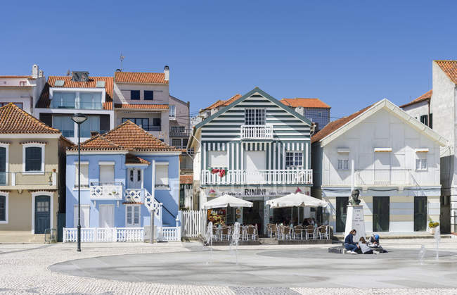Colorful houses of Costa Nova, a seaside resort and suburb of Aveiro.  Aveiro in Portugal on the coast of the Atlantic. Because of the many channels Aveiro is called the venice of Portugal. — Stock Photo