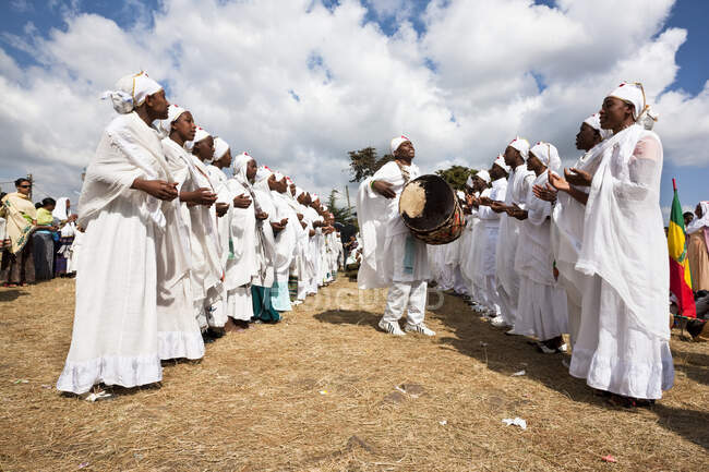 Groups of dancers and musicans are celebrating timkatTimkat cerimony of the ethiopian orthodox church, Timkat procession is entering the jan meda sports ground in Addis Ababa, where the three day cerimony takes place, Timkat  is also the celebration — Stock Photo
