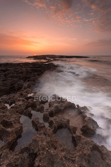Sunrise at Punta Sottile cape, Lampedusa island, Pelagie Islands, Mediterranean Sea, Sicily, Italy, Europe — Stock Photo