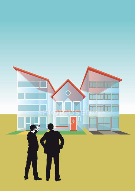 Two businessmen talking at transparent houses — Stock Photo
