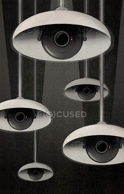 Ojos de CCTV bajo pantallas de lámparas mirando - foto de stock