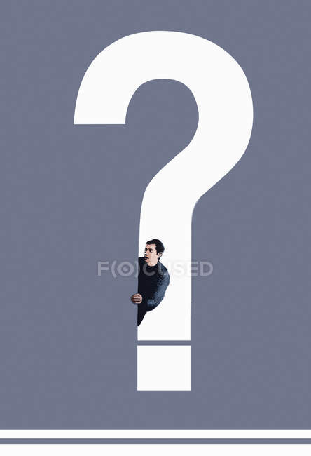 Man looking out from question mark — Stockfoto
