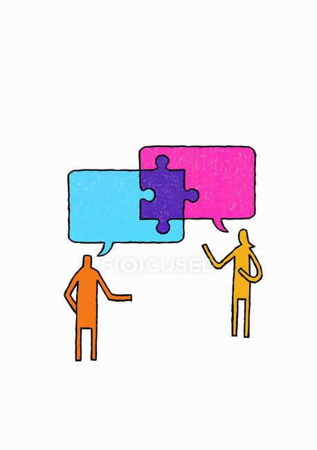 Jigsaw piece connecting speech bubbles above man and woman — Stock Photo
