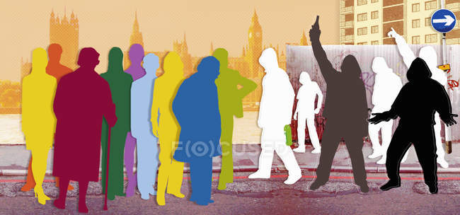 Urban youth confronting multicolored adults on London street — Stock Photo