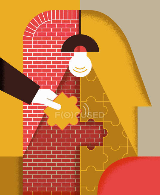 Puzzle d'assemblage de main sur le mur de briques — Photo de stock
