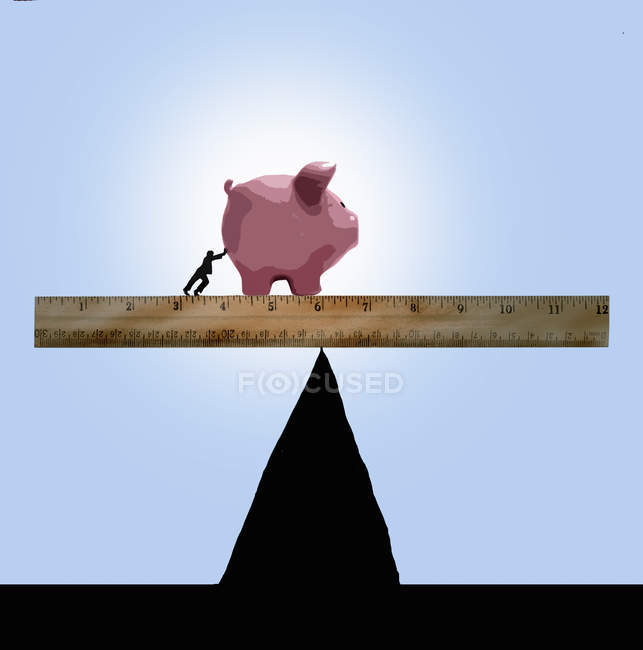Person pushing piggy bank on ruler on top of peak — Stock Photo