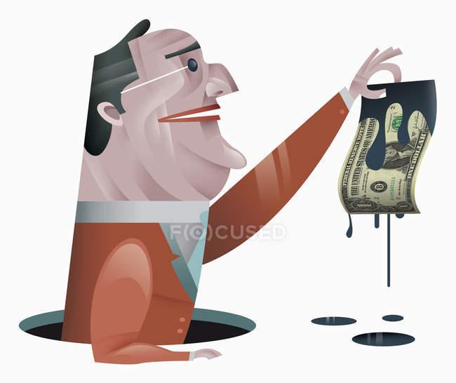 Empresário segurando nota de dólar pingando petróleo — Fotografia de Stock