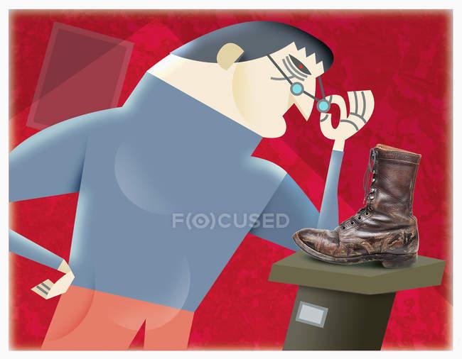 Человек смотрит на художественную обувь — стоковое фото
