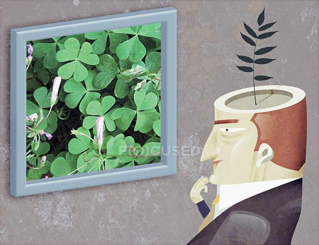 Человек с растением, растущим из головы — стоковое фото