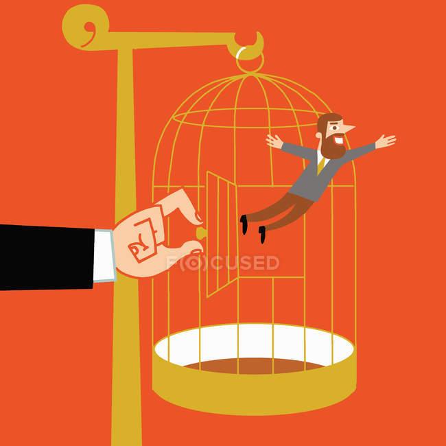 Hand loslassen Mann aus Vogelkäfig — Stockfoto