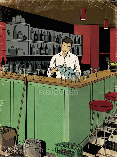 Barman cleaning glasses after closing time — Stock Photo