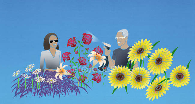 Woman and man caring for flowers — Stock Photo