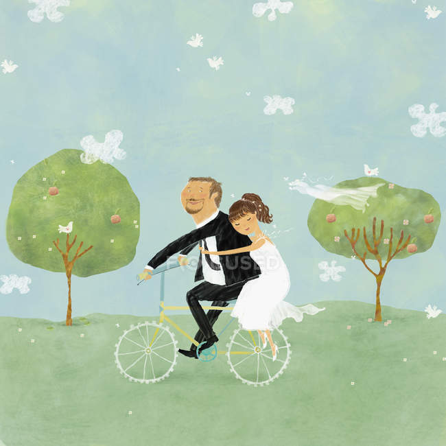 Bride and groom on bicycle in park — Stock Photo
