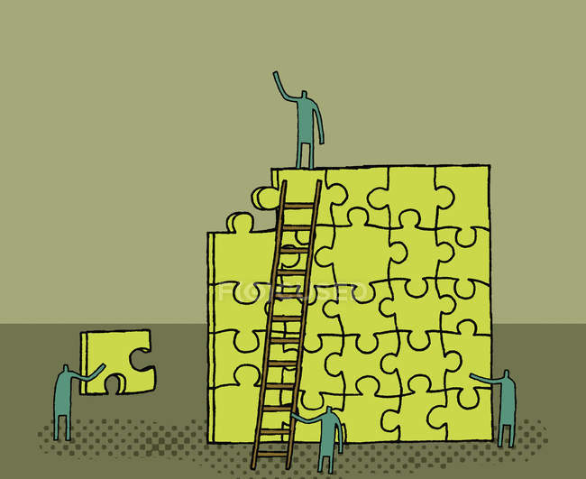 Workers building yellow puzzle — Stock Photo