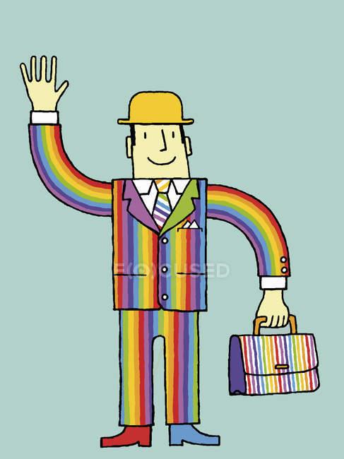 Бізнесмен в веселку костюм розмахуючи рукою — стокове фото