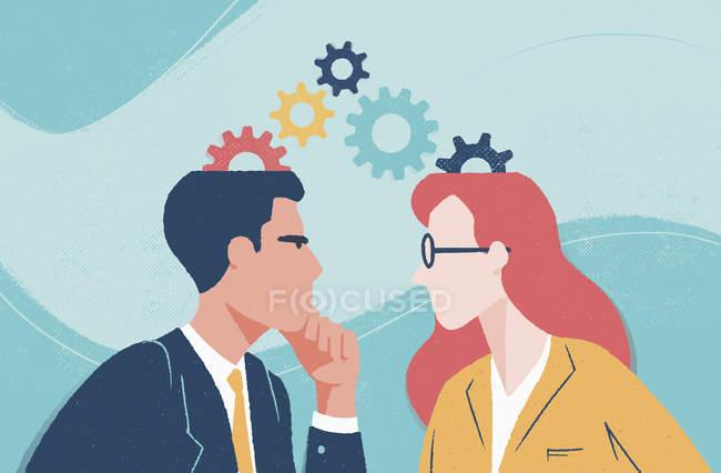 Homme d'affaires et femme d'affaires avec des rouages au-dessus de leurs têtes faisant face à l'un l'autre — Photo de stock