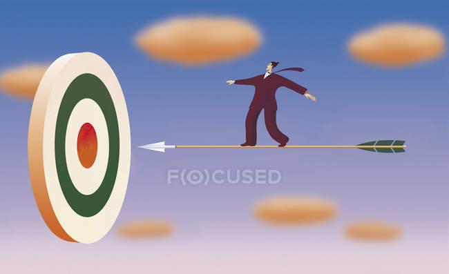 Businessman on arrow flying towards target — стоковое фото