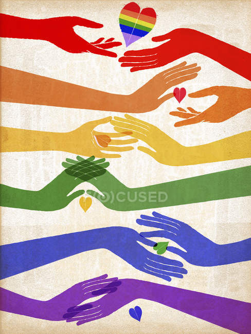 Hands and heart in shape of rainbow flag — Stock Photo
