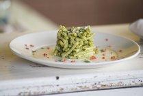 Strozzapreti pasta with celery pesto and aromatic herbs. — Stock Photo