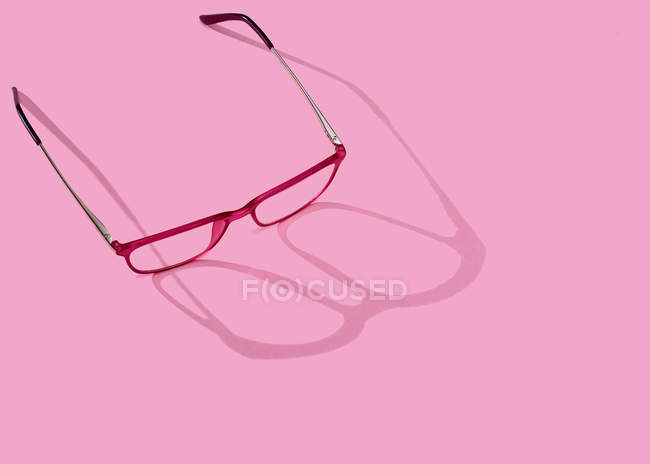 Conceptual image of glasses on pink background — Stock Photo