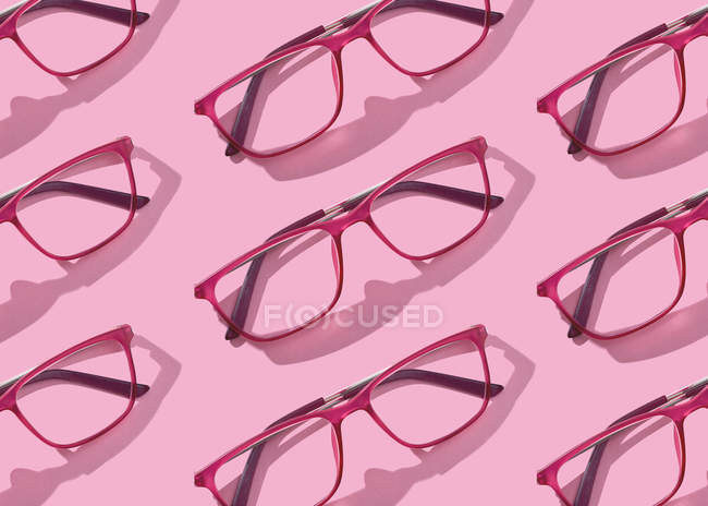 Conceptual image of glasses collections on pink background — Stock Photo