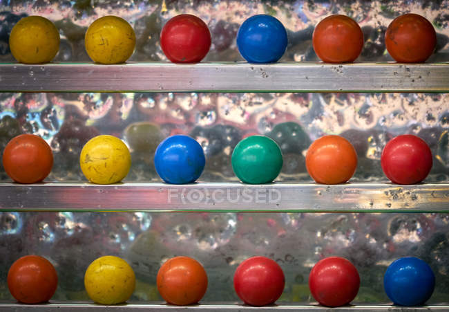 Colorful balls to shoot in amusement stand — Stock Photo