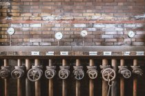 Thermal power station by brick wall — Stock Photo