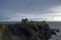 Castle ruins at the rocky coast — Stock Photo