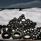 Daytime view of different rubber tires on white fabric covered hills — Stock Photo