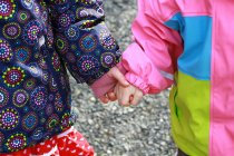 Cropped view of children holding hands — Stock Photo