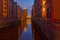 Illuminated buildings with water chanel — Stock Photo