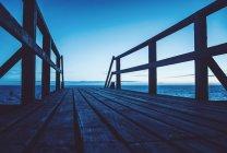 Empty footbridge with landscape on horizon — Stock Photo