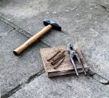 Hammer and iron nails on floor — Stock Photo