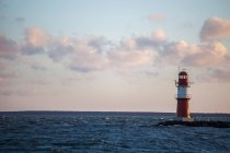 Red lighthouse in Warnemuende — Fotografia de Stock
