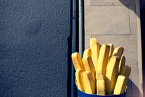 Daytime view of French fries sculpture on building wall — Stock Photo