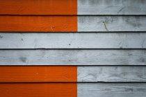 Vista della parete in legno verniciata di arancione — Foto stock