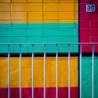 View of building number on colorful wall with railing on foreground — Stock Photo