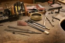 Tools on wooden table in jewelry crafts workshop — Stock Photo
