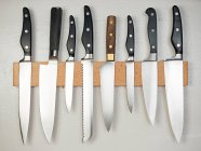 Front view of knives set on rack — Stock Photo