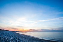 Seascape with sunset on the shore — Stock Photo